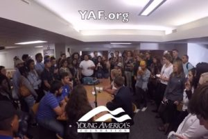 image screenshot of YAF video of protesters disrupting their meeting at University of Kansas